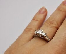 14 KT WHITE GOLD RING with WHITE PRINCESS CUT DIAMONDS