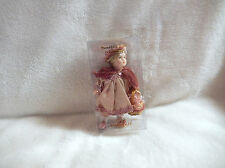 CHRISTMAS 5'' INCH PORCELAIN DOLL BRAIDED HAIR W/ MAUVE CAPE/BASKET ORN-NEW (1 )