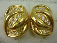 VINTAGE NOLAN MILLER CLEAR CRYSTAL GOLD TONE TWIST CLIP EARRINGS