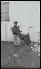 Glass Magic Lantern Slide SOLDIER READING A PAPER IN WICKER CHAIR C1910 PHOTO