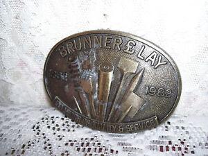 Carpenter Belt Buckle Brunner & Lay 1882 - 1982