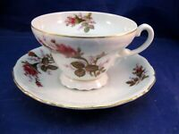 ANTIQUE TEA CUP AND SAUCER WITH EMBOSSED PATTERN AND ROSE DECORATION