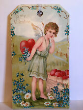 TO MY VALENTINE CUPID GIRL SIGN. Standing in a garden of Forget Me Not Flowers.