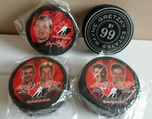 3 TEAM CANADA HOCKEY PUCKS - 3 McDonalds  & 1 Gretzky Estate Winery puck FREE!