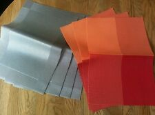 NEW 2 sets of 4 table easy clean placemats, grey/silver & red/orange