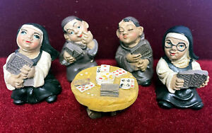 Nuns and Monks Playing Cards Statues