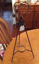 A TWISTED METAL STAND WITH A HEART SHAPE ON TOP AND A GLASS TEA LIGHT HOLDER #BR