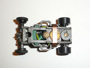 """AURORA AFX NON M/T MEAN GREEN HO SLOT CHASSIS """"WITH WEIGHT"""" IN USED CONDITION"""