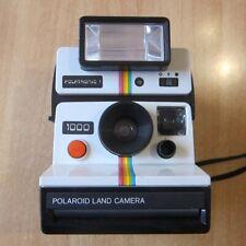 Polaroid 1000 Land Camera mit Polatronic 1 Blitzaufsatz - Sofortbildkamera