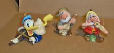 "Three Hanging Ornaments, ""Doc, Happy, & Donald Duck""."
