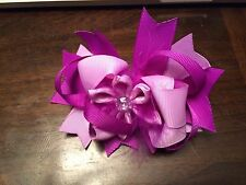 "Boutique hair bow purples w/flower ribbon & rhinestone in center 5"" on barrette"