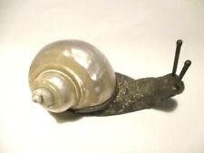 Soprammobile lumaca argentata con conchiglia naturale. 15cm