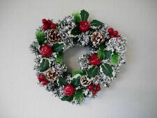 Ghirlande, corone e fiori natalizi rossi in abete