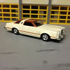 1/64 1978 Ford Thunderbird in Beige with a Brown Landau Top & Rubber Tires