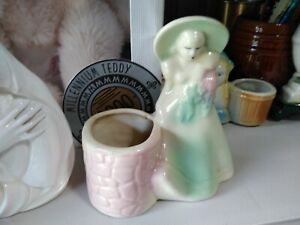 ceramic women wearing hat planter