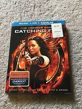 The Hunger Games: Catching Fire (Blu-ray Disc + DVD + Digital HD). Near perfect.