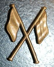 WWI Canadian Signals Corps brass sleeve badge (crossed flags)