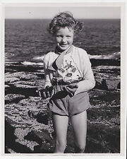 60s? News photo Little GIRL ON BEACH  Prickly Sea ball critters ? Vintage  PHOTO