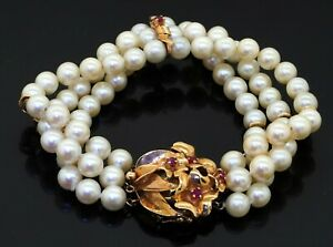 Vintage 14K yellow gold 0.73CT ruby flower triple strand bracelet