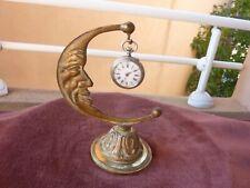 porte montre art deco bronze doré à la lune et montre de femme en argent