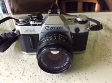 Canon AE-1 35mm SLR camera with lenses, strap and case