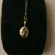 Gold Coloured Necklace And Locket, marked 9ct but not hallmarked