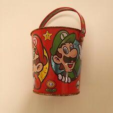 Nintendo 2013 Metal Tin Bucket Super Mario Bros Red Collectible Toy