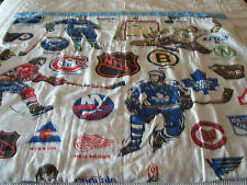 "VINTAGE HOME MADE 42"" BY 72"" CRIB BLANKET OR LAP COVER - NHL THEMED"