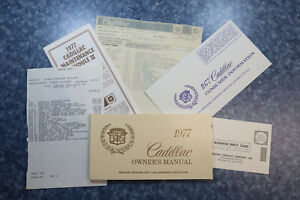 1977 Cadillac Owner's Manual and other paperwork.