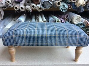 Footstool upholstered in a top quality grey wool effect fabric.