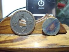 2 (two) Maverick Asian Tokens One Square Hole Copper Other Odd Symbols