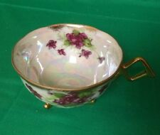 VINTAGE THREE FOOTED SHAFFORD TEA CUP--PURPLE FLORAL DESIGN--LUSTER-ODD HANDLE