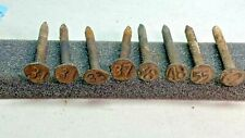 Variety of  Eight (8) Railroad Date Nails - Check out the font on the1955 nail!