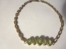 BEAUTIFUL 10 KT GOLD AND PERIDOT BRACELET...7 1/2 INCHES