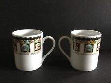 "Two Mary Engelbreit Porcelain Mugs ""Love Home Family Friends� 3 7/8� H 3 1/8� D"