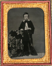AMBROTYPE BOY WITH 1850S RIFLE. AMBER GLASS, 1/4 PLATE FULL CASE.