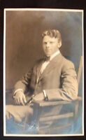 Real Photo, Divided Back Postcard - Young Man Sitting in a Chair