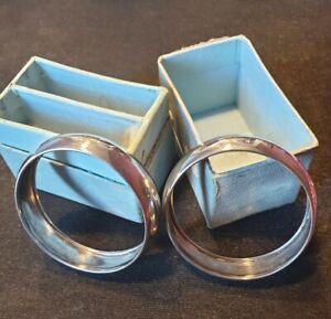 Pair of Francis Webb 1911 hallmarked solid silver napkin rings. In original box.