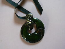 A Black Ribbin Necklace With A Lovely Silver Tone & Green Pendant.