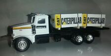 1/64 ERTL farm toy custom caterpillar Peterbilt truck w 4 cat skids speccast dcp