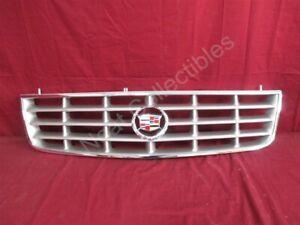 NOS OEM Cadillac Seville Radiator Grille 2004 Light Tarnished Silver
