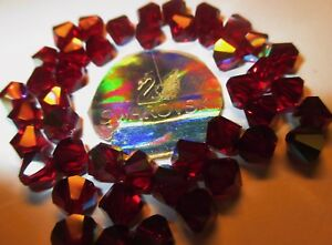 20 Swarovski Perlen 6 mmØ  Siam - rot AB # 5301-208-AB Aurore Borele Doppelkegel
