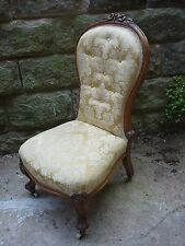 A late Victorian nursing chair, good condition in gold damask.