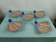 Set of five unusual Japanese Hanetsuki shaped porcelain chopstick rests.