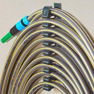 Hang a hose wall mounted garden hose holder