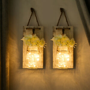 A pair of string lamps decorate the wall with wooden flower hanging bottles⭐