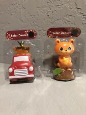 New Set of 2 Solar Dancing Thanksgiving Figurines: Squirrel & Harvest Truck