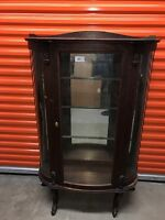 Round oak china cabinet- mirrored back with glass shelves from early 1900's