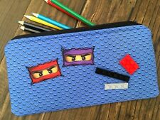 Handmade kids Ninjago inspired zipper pencil case with lego bricks attached