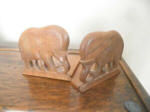 Pair of folding carved wooden elephant bookends, ethnic